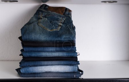 Piled Assorted Casual Jeans on White Shelf