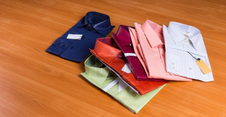 New Colorful Dress Shirts Fanned on Wooden Surface