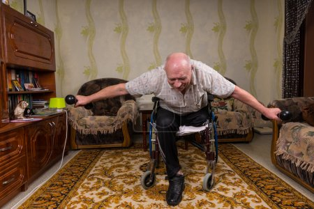 Disabled senior man leaned and doing exercises