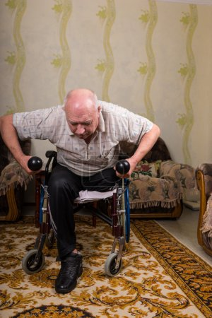 Disabled old man leaned and doing exercises