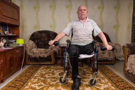 Disabled senior man lifting dumbbells at home