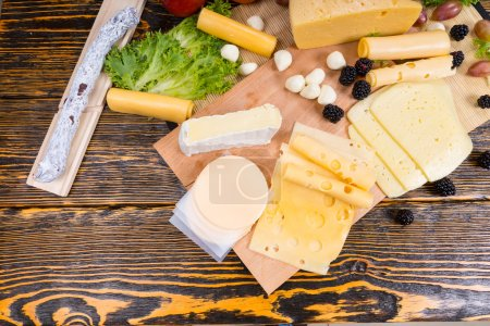 Gourmet Cheese Board on Rustic Wooden Table