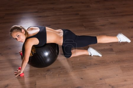 Young Woman Working Out with Exercise Ball