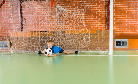 Young boy saving a goal in a soccer game