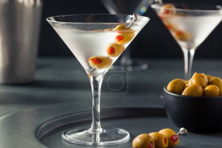 Photo for Classic Shaken Dry Vodka Martini with Olives - Royalty Free Image