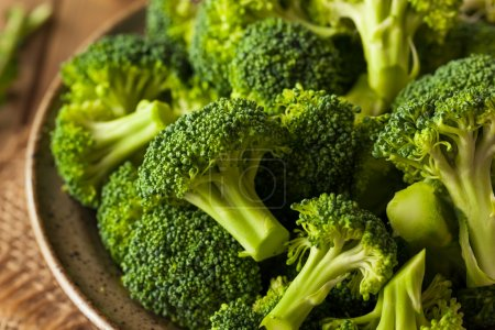 Photo for Healthy Green Organic  Raw Broccoli Florets Ready for Cooking - Royalty Free Image