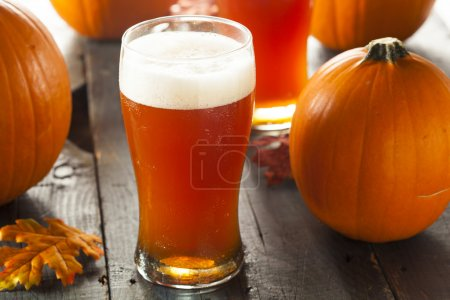 Photo for Frothy Orange Pumpkin Ale Ready to Drink - Royalty Free Image