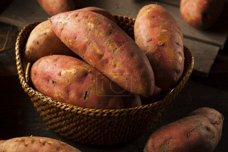 Photo for Organic Raw Sweet Potatoes on a Background - Royalty Free Image