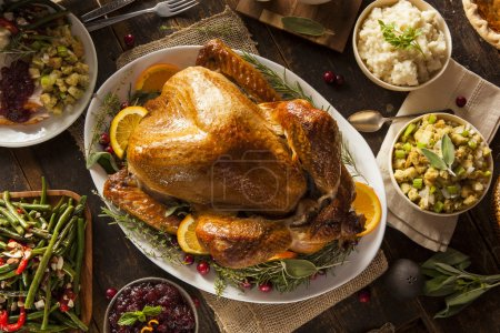 Photo for Whole Homemade Thanksgiving Turkey with All the Sides - Royalty Free Image