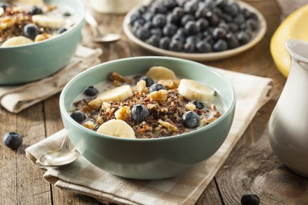 Photo for Organic Breakfast Quinoa with Nuts Milk and Berries - Royalty Free Image
