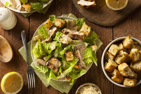 Photo for Healthy Grilled Chicken Caesar Salad with Cheese and Croutons - Royalty Free Image