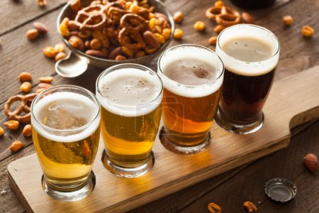 Photo for Assorted Beers in a Flight Ready for Tasting - Royalty Free Image