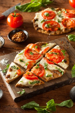 Photo for Homemade Margarita Flatbread Pizza with Tomato and Basil - Royalty Free Image