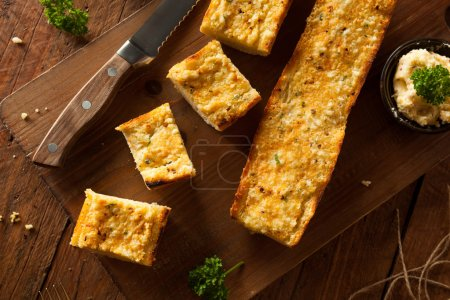 Photo for Homemade Cheesy Garlic Bread with Herbs and Spices - Royalty Free Image