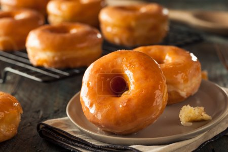 Photo for Homemade Round Glazed Donuts Ready to Eat - Royalty Free Image