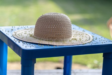 Straw hat on plastic table