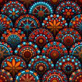 Colorful circle flower mandalas seamless pattern in blue red and orange vector