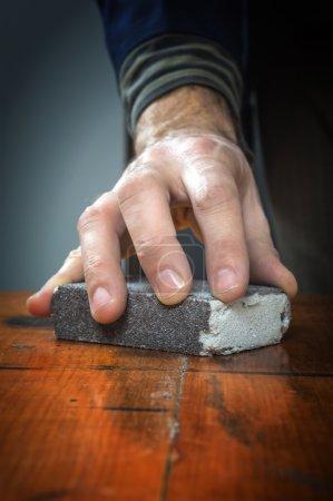 Handyman working with sandpaper