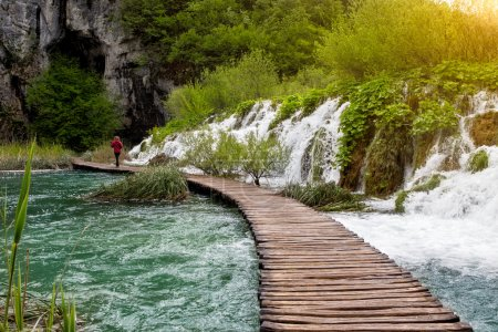 Beautiful view of waterfalls and pathway in Plitvice Lakes National Park.