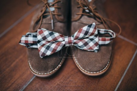 Bow tie on brown shoes