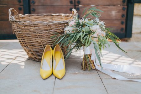Beautiful wedding bouquet and bridal shoes