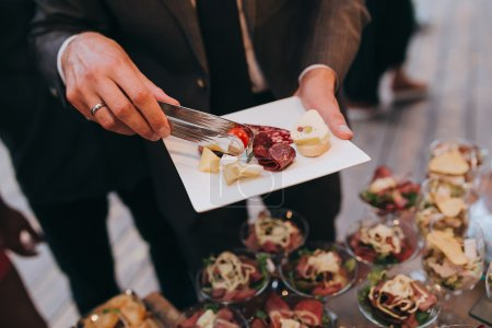 Guest at party with snack at plate