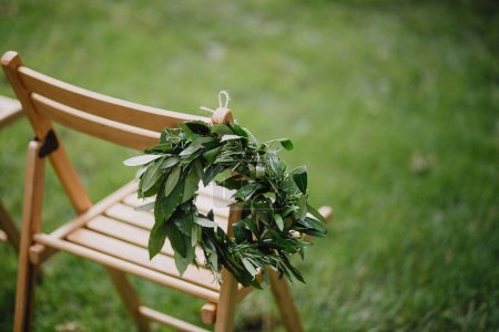 wooden chair with laurel wreath