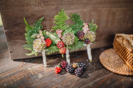 Wedding boutonniere on a vintage wooden table