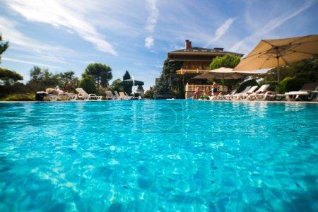 Beautiful swimming pool in tropical resort , close up