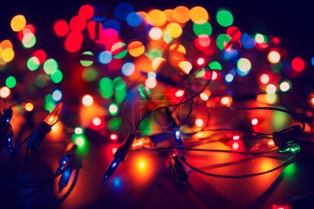 Photo for Christmas lights on dark background. Decorative garland. Tinted photo - Royalty Free Image