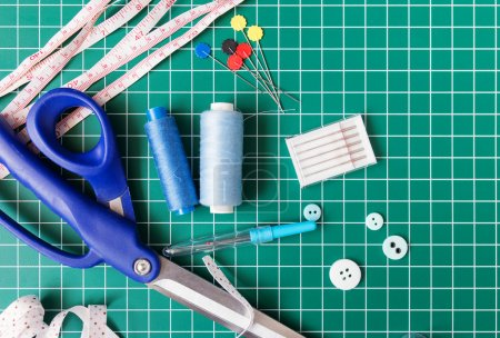 Patchwork sewing tools on green mat