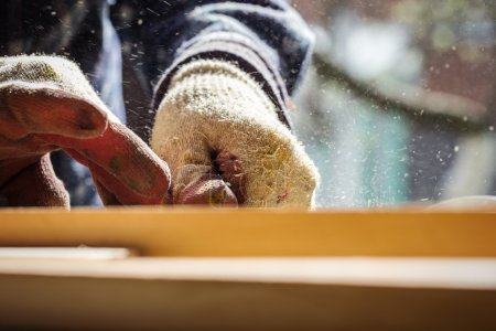 Carpenter working with wood, close up photo