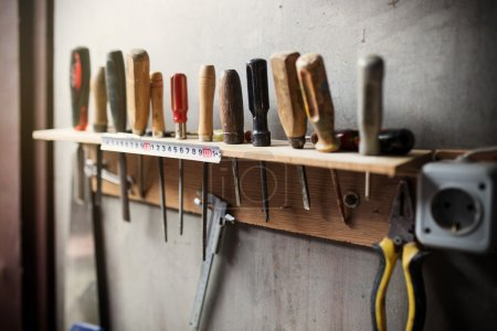 Old woodworking tools on wall, close up photo