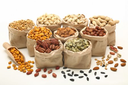 Photo for Variety mixed nuts and seeds in paper bags - Royalty Free Image