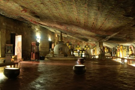 Photo for Interior of Dambulla Golden Temple in Sri Lanka. It is the largest and best preserved cave temple complex in the country. - Royalty Free Image