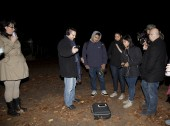 HUNTINGTON, NEW YORK, USA - NOVEMBER 14: Ron Yacovetti uses his audio recording device  as other members of the Brooklyn Paranormal Society of NY stand nearby during their investigation of Mount Misery Road in Long Island. Known for tales and legends