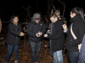 HUNTINGTON, NEW YORK, USA - NOVEMBER 14: Members of the Brooklyn Paranormal Society of NY during their investigation of Mount Misery Road in Long Island. Known for tales and legends of paranormal sightings.  They are standing and taking readings on t