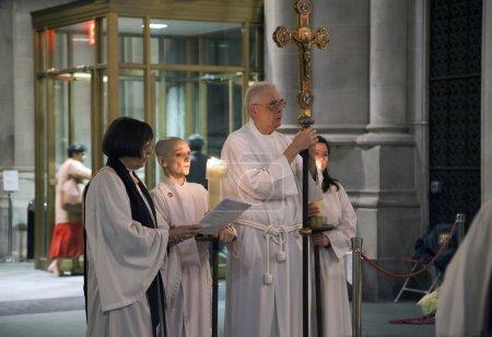 Priests in Prayer inside Saint