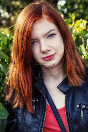 Charming girl teen with red hair