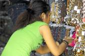 Young Thai woman selling jewellery