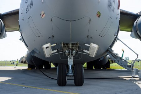 The front landing gear of a strategic and tactical airlifter Boeing C-17 Globemaster III.