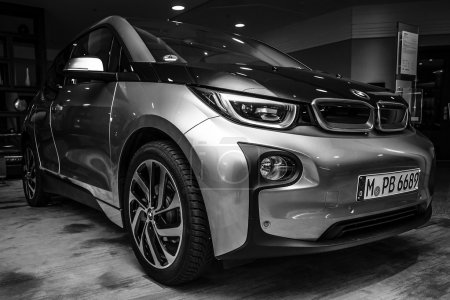 BERLIN - NOVEMBER 28, 2014: Showroom. The BMW i3, previously Mega City Vehicle (MCV), is a five-door urban electric car developed by the German manufacturer BMW. Black and white.