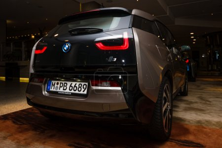 BERLIN - NOVEMBER 28, 2014: Showroom. The BMW i3, previously Mega City Vehicle (MCV), is a five-door urban electric car developed by the German manufacturer BMW. Rear view.