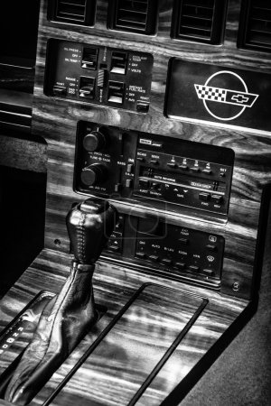 Shift knob of a sports car Chevrolet Corvette (C4) Targa, 1988. Black and white. The Classic Days on Kurfuerstendamm.