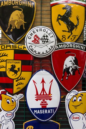 Background of various emblems of various car brands producing sports cars. The Classic Days on Kurfuerstendamm.
