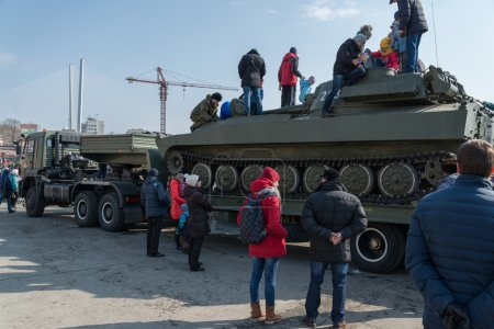 Children play on modern russian armored vehicle.