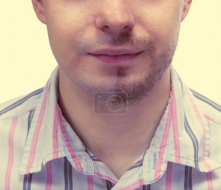 Man with a beard on half of the face.