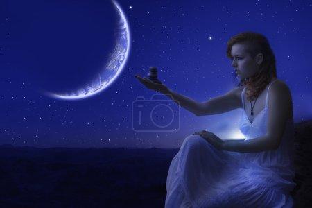 Woman holding zen stones.