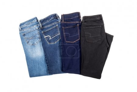 Four Pairs of Jeans Isolated on White