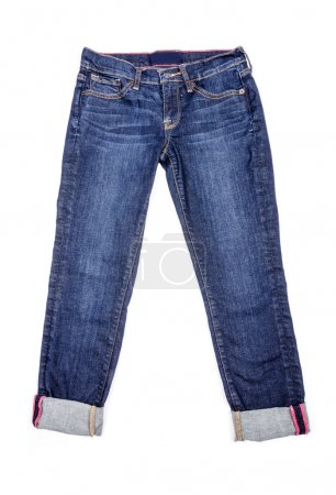 Photo for Pair of cropped blue denim jeans on white background. - Royalty Free Image